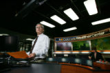 EJ012  CBS4's meteorologist Larry Green looks out the window just before breaking into regular...
