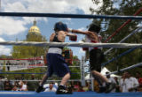 Jordan Howard, left, and Jose Estrella, right, box during the Touch Em Boxing Show Sunday...