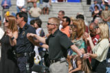 Denver police officer Jack Bishop (cq), center, joins in prayer during a Cinco de Mayo Mass Sunday...