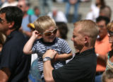 Denver police officer Jack Bishop (cq)  plays with his  three year old son Shane Bishop after a...