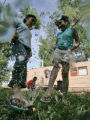 (L-R) Carmen Bocanegra (cq) 10, and her sister Herminia Bocanegra (cq) 8 play in the sprinkler in...
