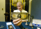 (DENVER, Colo., March 17, 2005)  State Treasurer Mike Coffman holds a 1922 twenty dollar bill,...