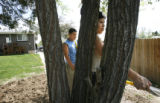 Jonathan Cortez, CQ, 12, left, helps his mother Ana Cortez, CQ, 30, water theri garden at their...