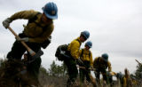 Pike Hotshots crew members  establish a fire line Tuesday, May 9, 2006 on a mock fire at Monument...