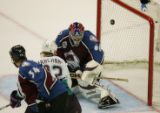 Colorado Avalanche's goal tender Jose Theodore, right, lets the puck slip past him shot by Joffery...