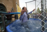 "DPS superintendent Michael Bennet gets dunked into a 400-gallon tank of water at a DPS ""Come..."