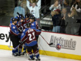 The Colorado Avalanche's Rob Blake (#4, center of group) celebrates with linemates including Joe...