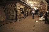 Real estate agent Stew Mosko walks in an underground   tunnel of an abandoned titan 1 missile...