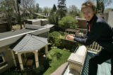 In Denver, Colo. on 5/10/06 Jennifer Bater stands on her balcony overlooking her recently...