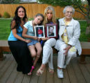 From left, Christine Goodman (widow), CQ, Kailya Goodman (daughter), CQ, Carol Vizzi (mother), CQ,...