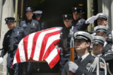 Emerging from the church carrying the remains of firefighter Lt Rich Montoya pallbearers from his...