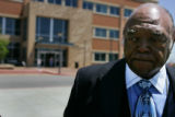 Bishop Acen Phillips talks about Shely Lowe outside the Arapahoe Centrepoint Plaza on May 12,...