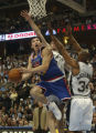 Denver, Colo., photo taken April 1, 2005- Denver Nugget's forward, Eduardo Najera (cq left) makes...