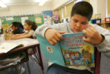 "Third-grader Emilio Soto (cq), 9, right, reads ""Little Critter's Bedtime Storybook"" at..."