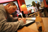 Alcohol compliance investigator Troy Croswhite (cq) writes up a citation at the AMF Littleton...