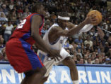 (Denver, Co., March 18, 2005)  Carmelo Anthony drives toward the basket past the LA Clippers'...