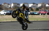Sean Howard, 21, of Colorado Springs practices some slow-speed stunts in the lower parkinglot of...