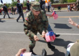 MSG Janice Bates (cq) with the 244 Engineer Combat Battalion hands out flags during Commerce...