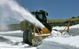 Snow Plow operator Doug Grice clears snow on Trail Ridge Road in Rocky Mountain National Park...