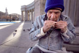 (DENVER, Co. - SHOT 3/16/2005) Robert Jones, 54, rolls a cigarette in Civic Center Park one...