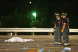 GRAPHIC CONTENT!! Sheridan firefighters inspect the scene of a fatal automobile accident on...