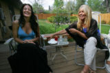 Christine Goodman, CQ, 31, left, (Justin Goodmans widow) laughs with Carol Vizzi, CQ, 52, right,...