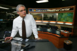 EJ012EJ012  CBS4's meteorologist Larry Green looks out the window just before breaking into...