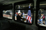 United States Senator Ken Salazar, framed by window of new bus, (white cowboy hat), member of the...