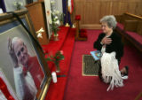 (DENVER, Colo., April 3, 2005) Helen Schempf (cq), 74, of Denver prays in front of a picture Pope...
