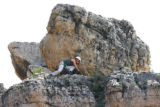 Alpine Search and Rescue team member Joelle Witmer searches along a rock face above Shelf road for...