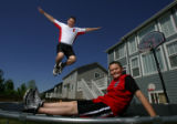 Chris Fushimi (cq) jumps on the trampoline with his son, Jordan (cq), 11, in their backyard in...
