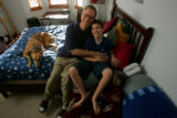 Doug Randolph(Cq) sits with his son, Brett (cq), 10, in Brett's room in their home in Lone Tree,...