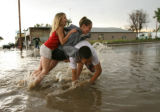 Vanessa Addleman, 10, and sister Kristen, 15, try to push Kristen's boyfriend Ray Casados (cq)...