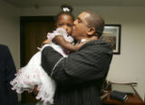 (DENVER, Colo., March 20, 2005) Reverand joseph Nixon gives a kiss to Mariah Goff on Palm Sunday...