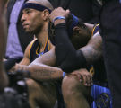 Denver Nuggets forward Kenyon Martin, left, sits next to a dejected Carmelo Anthony during a time...
