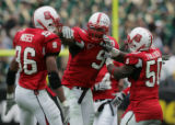 STATE15.SP.123105.EDH   NC State's Renaldo Moses celebrates with Mario Williams and Stephen...