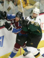 Karlis Skrastins and Bill Guerin collide in the second period of the Colorado Avalanche against...