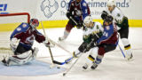The Colorado Avalanche's Jose Theodore (#60) blocks a shot by the Dallas Stars' Bill Guerin (#13)...