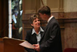 (LT. TO RT.) Colorado Senate President Joan Fitz-Gerald, holds back tears and is comforted by...