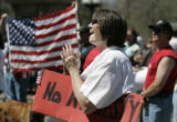 Darlene Dennison (cq) from Lakewood, CO cheers as she holds a sign during a rally for Defend...