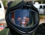 Andrianna Weathersby (cq), is all smiles as she wears the  protective Bomb Squad helmet Thursday...