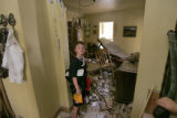 In Denver, Colo. 4/26/06, Grayson Hovey,(cq) 7 takes a look at the rubble in the home of his...