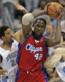 Denver Nuggets players Andre Miller, left, guards Los Angeles Clippers forward Elton Brand,...