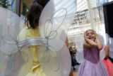 Dressed as a fairy, Barnum Elementary student Brenda Ruiz, 9, right, shows her excitement moments...