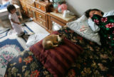 Graciela Martinez, CQ, 12, right, lies on her bed after visiting her father, Marcos Martinez's,...