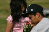 Lorena Martinez, 9, CQ, left, and her brother Alejandro Martinez, CQ, 14, right visit their...