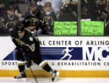 Stars fans display their desires on a sign, as Dallas' Niklas Hagman (15) passes by their seats,...