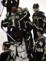 Dallas Stars goalie Marty Turco (35) gets hugged by teammate Johan Hedberg (1 - left), after the...