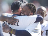DTS107 - Detroit Tigers' Dmitri Young, right, hugs manager Alan Trammell after the Tigers' 11-2...