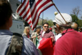 Rafael Cardenas (cq, center holding Mexican flag) of Denver argues with anti-illegal immigration...
